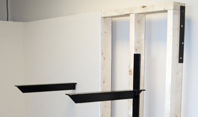 two extended concealed brackets, one behind drywall and one in an open wall