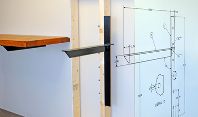 an illustration of how to install an extended concealed bracket and a shelf on the bracket