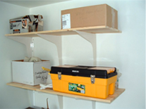 two shelves in a garage supported with concealed brackets