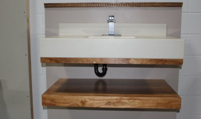 A wide shot of a sink and table held up using the floating vanity bracket showing that the bracket and even the inlaid sink are hidden